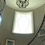 Curved Staircase and Round Window